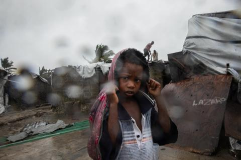 Residents of the Praia Nova neighbourhood in Beira seek shelter and protection from Tropical Cyclone Eloise.