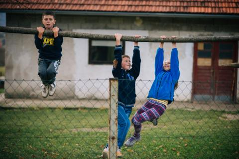 Children posing for their friends during the Inclusive photo workshop in Krnjeusa (Bosnia and Herzegovina).
