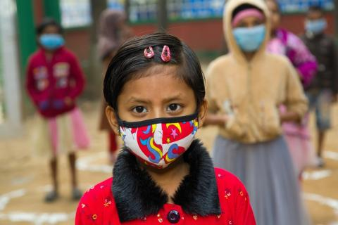 A child from the Lalmatia slum, wearing a mask due to the COVID-19 pandemic