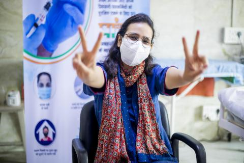 Dr. Farah Husain celebrates as she receives a second dose of COVID-19 vaccine at Lok Nayak Jai Prakash Hospital in New Delhi, Delhi, India.