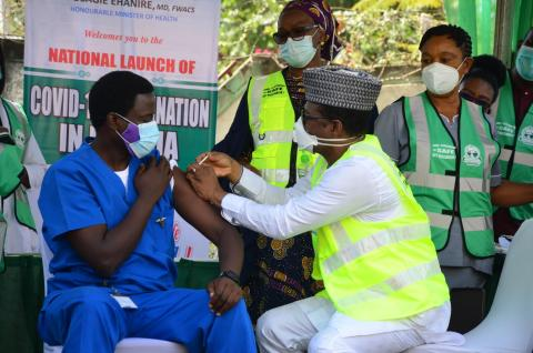 A health workers is vaccinated a doctor how has been working in the isolation centre in Abuja, Nigeria.