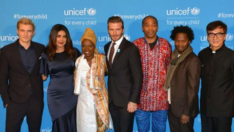 UNICEF Goodwill Ambassadors standing infront of a UNICEF branded backdrop