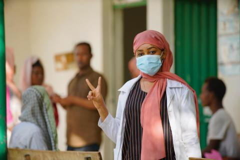 Hanan Kasim, a health worker at Logia health center in Afar, Ethiopia, gets vaccinated.