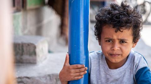 Yemen. A small child looks at the camera.