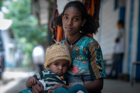Ethiopia. A woman holds her child at a health centre in Tigray.