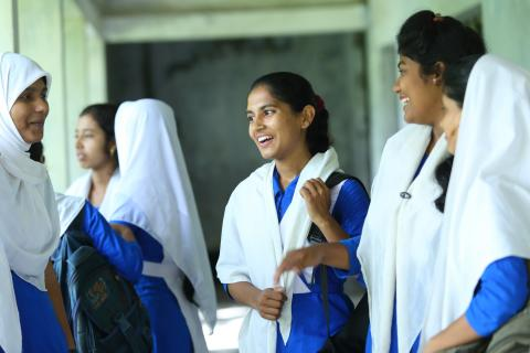 Fifteen-year-old Shampa, center, attends school with her classmates at Palli Mangal Girls High School, Gobor Chaka, Khulna City Corporation, in Bangladesh.