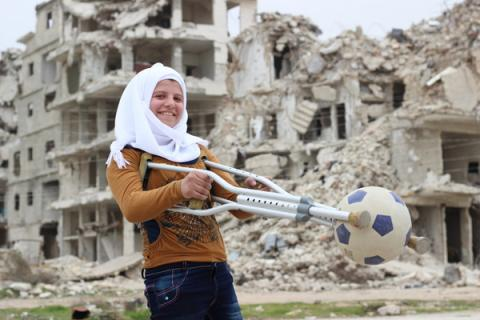 Saja, 13, plays with her football.