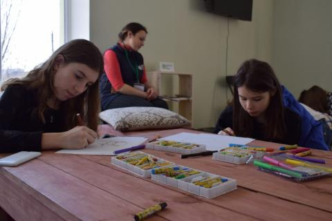 Adolescent girls attend an art therapy session