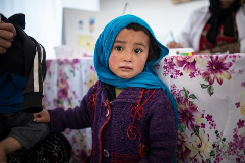 A girl sits at a health clinic, Afghanistan