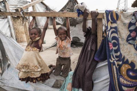 Children play on the frame of a shelter at the Gaoui camp for Chadian returnees from the Central African Republic, in Gaoui, 15 kilometres northeast of N'Djamena, Chad.
