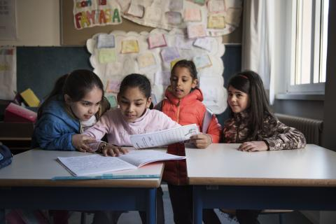 Nine-year-old Syrian refugee Badiaa sits at a desk with Italian and Syrian friends in her classroom at a public elementary school in Trento, Trentino province, Italy, Tuesday 2 May 2017