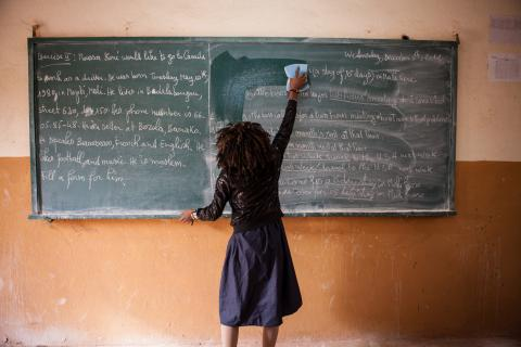 A female student cleans a chalkboard at a school in Bamako, Mali.