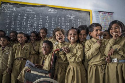 Students pose for a photograph inside their classroom in India in 2013.
