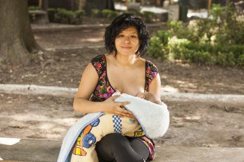 a woman breastfeeds a baby in Mexico