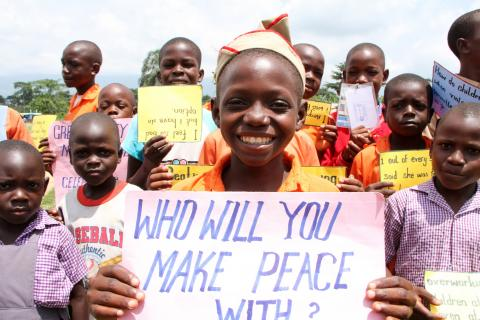 Uganda. Pupils at a school display placards calling for peace.