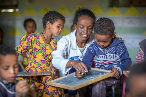 A teacher in Ethiopia helps her pre-primary students learn with personal chalkboards.