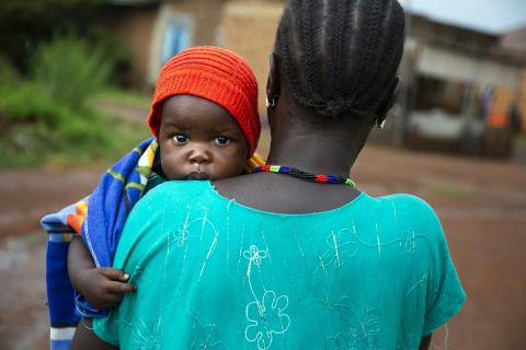 Veronica carries her youngest child, Mubarak (9 months), at the hospital in Wau, South Sudan.