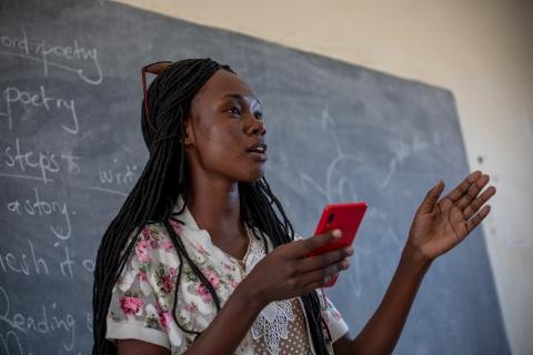 Nyajima Mut, 17, recites a poem she wrote on peace, to fellow classmates in Juba, South Sudan on 28 January 2020.