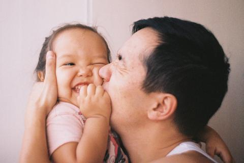 UNICEF Parenting: Tips and resources for parents - A father kisses his child