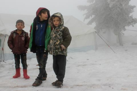 Syria. Children stand together at an informal settlement in the Syrian Arab Republic near the Turkish border.