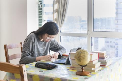 China. A student studies at home