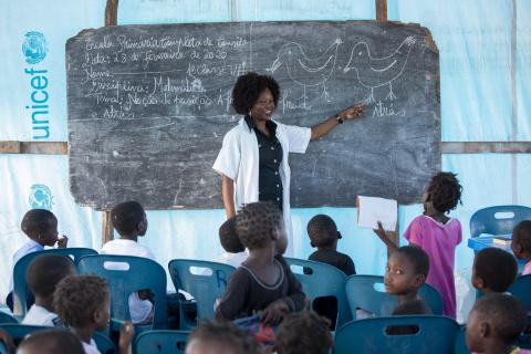 Mozambique. A teacher hosts a lesson at a UNICEF-supported school.