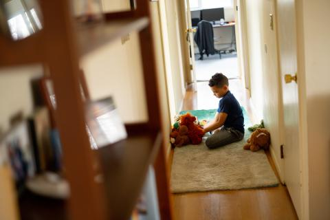 Coronavirus (COVID-19): Luka, 8, plays with stuffed animals in between completing school exercises on his first day of distance learning from home.