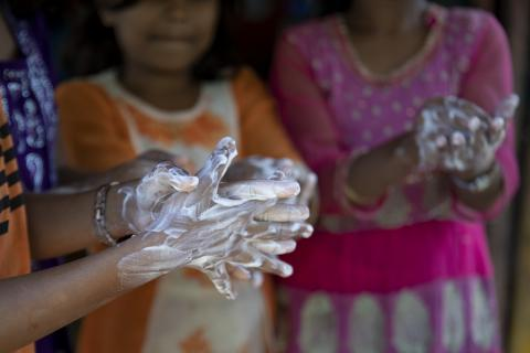 Children wash their hands with soap at a UNICEF-supported learning centre in the Kutupalong camp, a Rohingya refugee camp, in Cox's Bazar, Bangladesh.