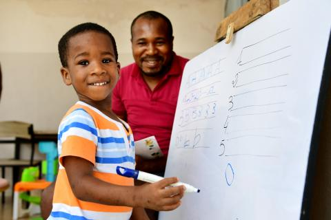 Paul, a 3-year-old boy is studying at home with his father Roger Niamien, in Abidjan, in the South of Côte d'Ivoire.