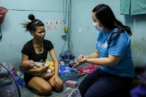 UNICEF staff gives bars of soap and hand-sanitizers to children and families in Bangkok's Klongtoey community while demonstrating how to correctly wash their hands to protect themselves from COVID-19 pandemic.