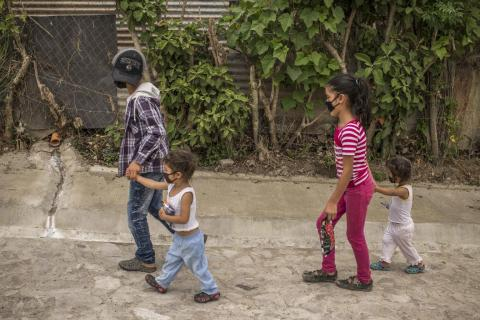 Children wear masks to get essentials at a nearby grocery store in Palencia, Guatemala.