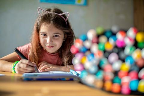 On 7 April 2020 in Kyiv, Ukraine, Masha, 9, draws a comic in her sketchbook.