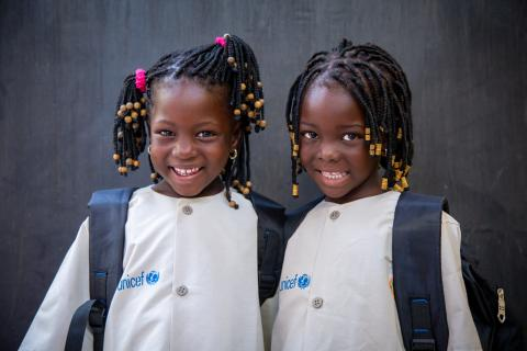 Smiling girls at the launch of the education center for out-of-school children.