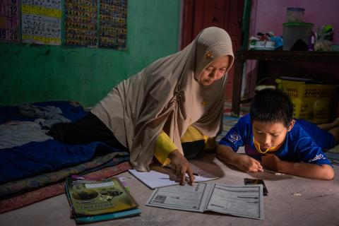 Syaiful, 12, studies at home with his mother, Nurhidayah, in Banyumas, Central Java, Indonesia, in 2020.