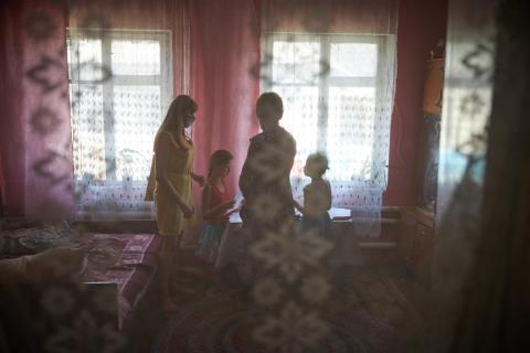 On 6 August 2020, psychologist Olena Davydova (left) meets with a family in Bilokurakyno, Eastern Ukraine.