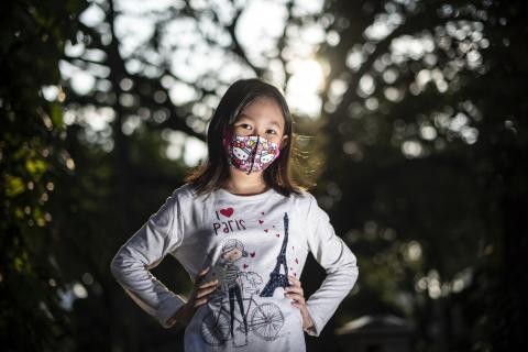 COVID-19 and masks: Adelina Salasika, 8, wears a cloth mask in Central Jakarta, Indonesia, 14 August 2020.