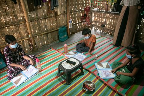 Bangladesh. Children study inside.