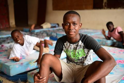 Côte d'Ivoire. A teenager sits at a protection centre.