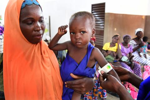 Burkina Faso. A child is check for malnutrition.