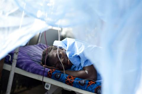 A woman in Sierra Leone sleeps after giving birth to a stillborn baby at home after 10 hours of labour. She was brought to the hospital for emergency removal of a retained placenta. Of eight pregnancies, she has four surviving children.