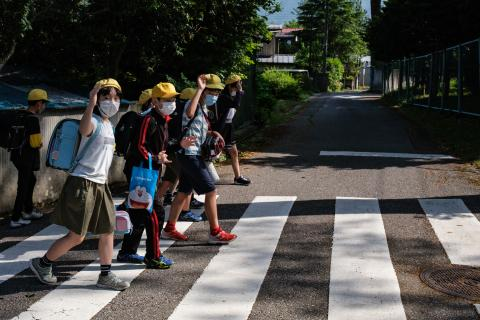 School children walk on a cross-walk
