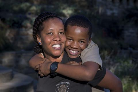 Mental health in Namibia: a teenage boy and his mother embrace