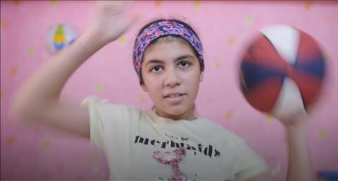 Learning in Egypt: a girl spins a basketball in her room