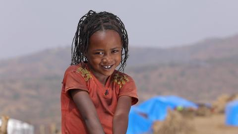 Ethiopia. A girl smiles at the camera.