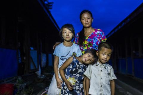 Myanmar. A family stands in an IDP camp.