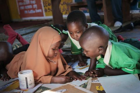 Children draw in the nursery classroom in Wakiso, Uganda.