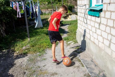 Ukraine. A boy kicks a football.