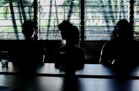 Silhouette of a boy, a girl, and their mother, El Salvador