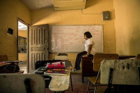 A student sits in a classroom in Honduras.