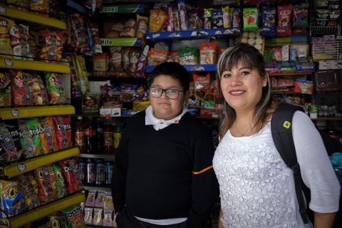 Mexico and obesity: A young boy and his mother stand in front of shelves lined with processed foods in Mexico City.